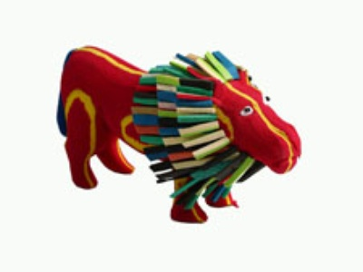 A small lion made of used flip-flop sandals